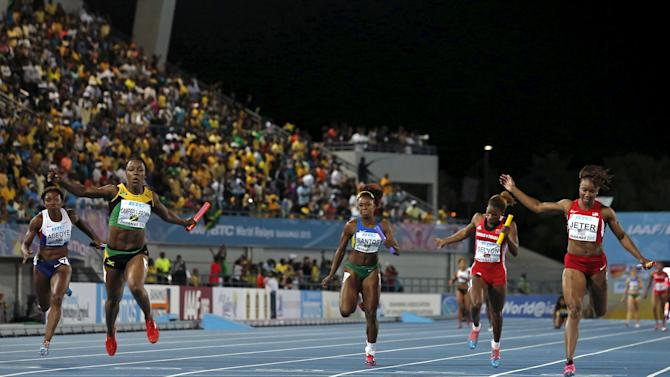 Jamaica's Veronica Campbell-Brown crosses the finish line first as Jamaica wins the women's 4x4100 relay race at the IAAF World Relays Championships in Nassau