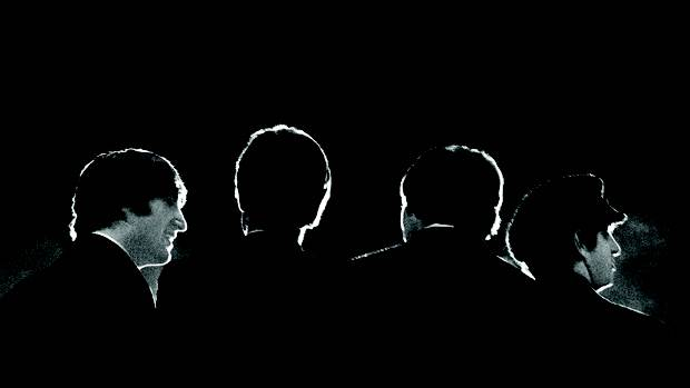 This Feb. 11, 1964 image provided by the David Anthony Fine Art gallery in Taos, N.M., shows a photograph of the Beatles taken by photographer Mike Mitchell during a news conference before the band's first live U.S. concert at the Washington Coliseum. Mitchell's portraits of the Beatles are the centerpiece of a monthlong photography exhibition at the gallery. This marks the first time the images have been shown since their unveiling in 2011 at a Christie's auction in New York City. (AP Photo/David Anthony Fine Art, Mike Mitchell)