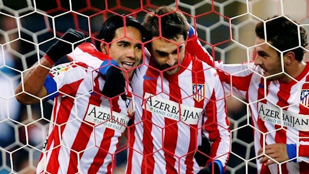 Adrian, right, with Atletico Madrid team-mates Radamel Falcao and Jorge Resurreccion Koke (Reuters)