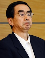 Fukui Governor Issei Nishikawa (pictured) listens to Trade and Industry Minister Yukio Edano during his meeting with prime minister Yoshihiko Noda at Noda&#39;s official resicence in Tokyo, June 16. Noda ordered nuclear reactors back online, defying public sentiment against atomic power following last year&#39;s meltdowns at Fukushima sparked by a huge quake-tsunami disaster