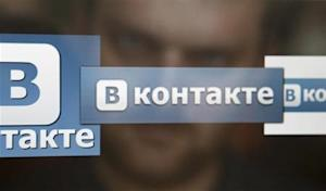 A man looks at a computer screen showing logos of Russian social network VKontakte in Moscow