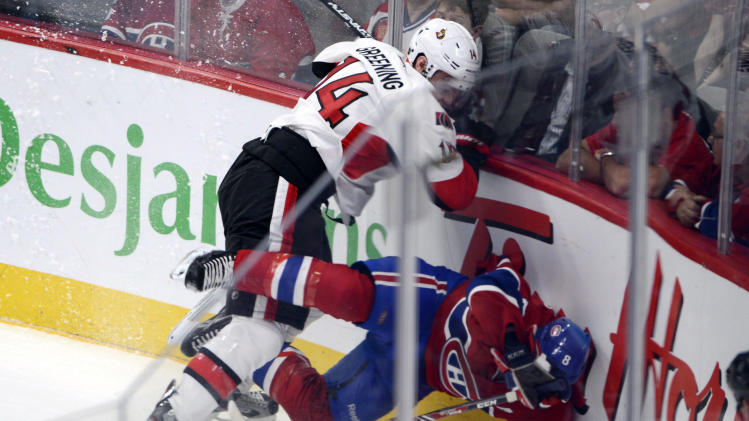 Ottawa Senators forward Colin Greening, top, hits Montreal Canadiens forward Brandon Prust during second-period NHL hockey Game 2 first-round playoff action in Montreal, Friday, May 3, 2013. (AP Photo/The Canadian Press, Ryan Remiorz)