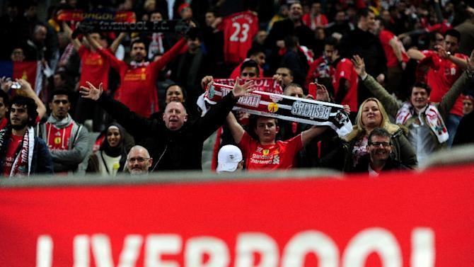 Liverpool's fans cheer their team during the UEFA Europa League first leg football match between Liverpool and Besiktas at Ataturk Olympic stadium on February 26,  2015