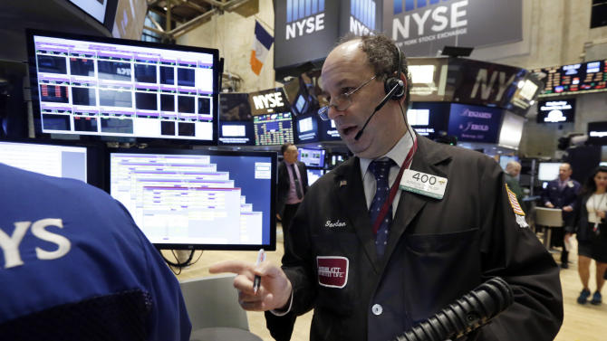 Trader Gordon Charlop works on the floor of the New York Stock Exchange, Friday, Oct. 2, 2015. A weak report on the U.S. jobs market is sending the stock market and the dollar sharply lower in early trading. (AP Photo/Richard Drew)