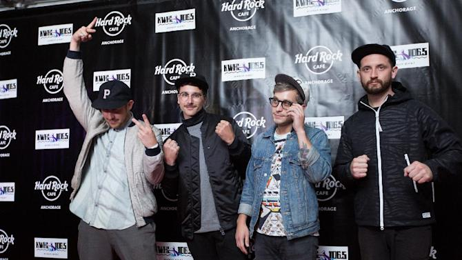 John Baldwin Gourley, Zach Carothers, Kyle O'Quin and Jason Sechrist of Portugal. The Man walk the red carpet at the Grand Opening party of Hard Rock Cafe Anchorage on Fri., Sept. 19, 2014 in Anchorage, Ala. (Photo by Kerry Tasker/Invision for Hard Rock International/AP Images)