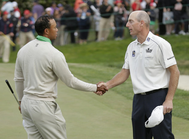 Tiger Woods shakes hands with Jim Furyk after the third round of the U.S. Open Championship golf tournament Saturday, June 16, 2012, at The Olympic Club in San Francisco. (AP Photo/Charlie Riedel)