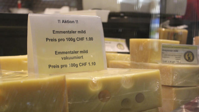 """In this photo taken Tuesday, Aug. 23, 2011, a discount is advertised for Emmental cheese in Affoltern im Emmental, Switzerland. The Emmental Show Dairy cranked out 1.2 million pounds (550 metric tons) of cheese three years ago, but now makes a third less and might be forced to cut back to a few wheels a day _ just to show tourists. The strength of the Swiss franc is driving down profits in this Alpine nation, poking holes in the finances of making Emmental, popularly known as """"Swiss cheese"""" in North America.  (AP Photo/Mark D. Carlson)"""