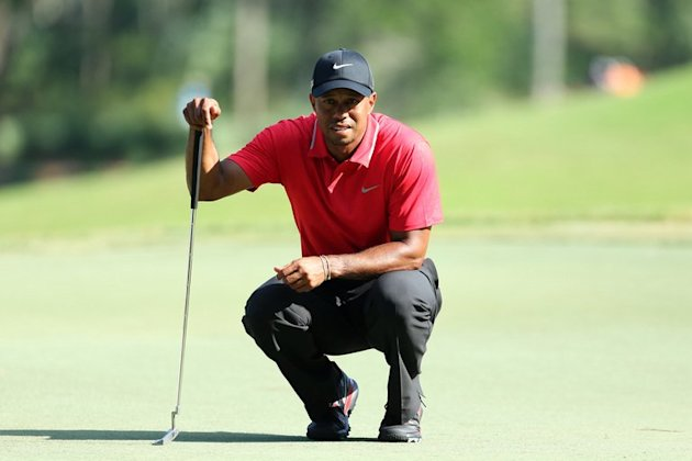 Tiger Woods lines up a birdie putt at TPC Sawgrass on May 12, 2013 in Ponte Vedra Beach, Florida