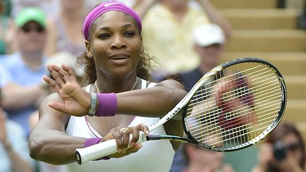 Serena Williams of the U.S. celebrates after defeating Melinda Czink of Hungary in their women's singles tennis match at the Wimbledon tennis championships in London June 28, 2012 (Reuters)