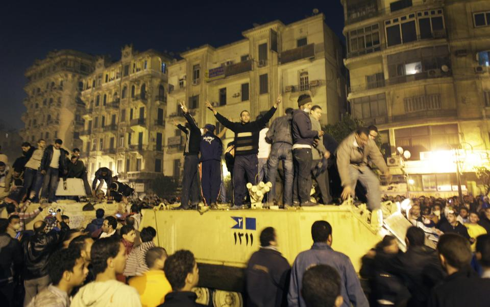 An Egyptian Army armored personnel carrier is surrounded by anti-government protesters near Tahrir square in downtown Cairo, Egypt, Friday, Jan. 28, 2011. (AP Photo/Ben Curtis)