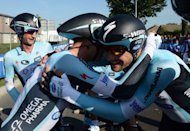 Omega Pharma's Belgian Tom Boonen (R) and Netherlands Niki Tepstra (L) react after winning the Men's Team Time Trial at the UCI Road World Championships in Valkenburg