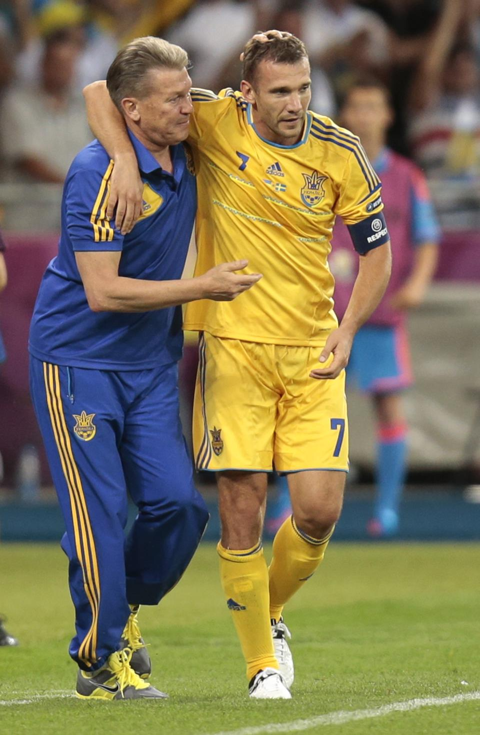 Ukraine's Andriy Shevchenko, right,  celebrates with Ukraine head coach Oleg Blokhin after scoring his second goal during the Euro 2012 soccer championship Group D match between Ukraine and Sweden in Kiev, Ukraine, Monday, June 11, 2012. (AP Photo/Ivan Sekretarev)