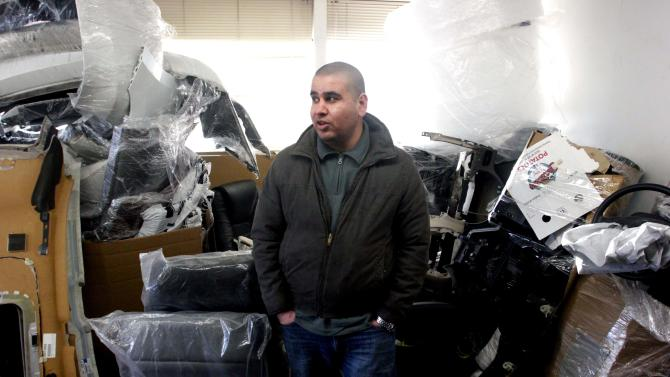 In this March 20, 2013 image, Iraqi immigrant Ubaida Mufrej stands in the office of his car parts export business in Seattle. Mufrej came to the United States under a special visa program for Iraqis who worked with U.S.-led forces during the Iraq War. The federal government has issued less than a quarter of 25,000 visas available and the program is scheduled to end this year. (AP Photo/Manuel Valdes)