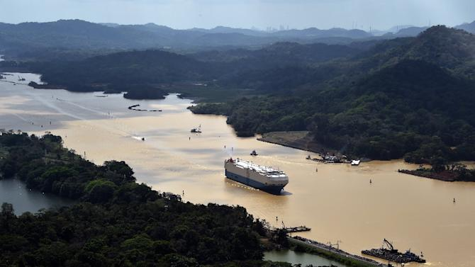 A merchant ship sails along the Panama Canal, on March 23, 2015