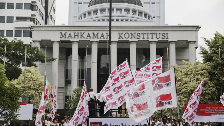 Supporters of Indonesia's losing candidate Prabowo rally outside the Constitutional Court in Jakarta