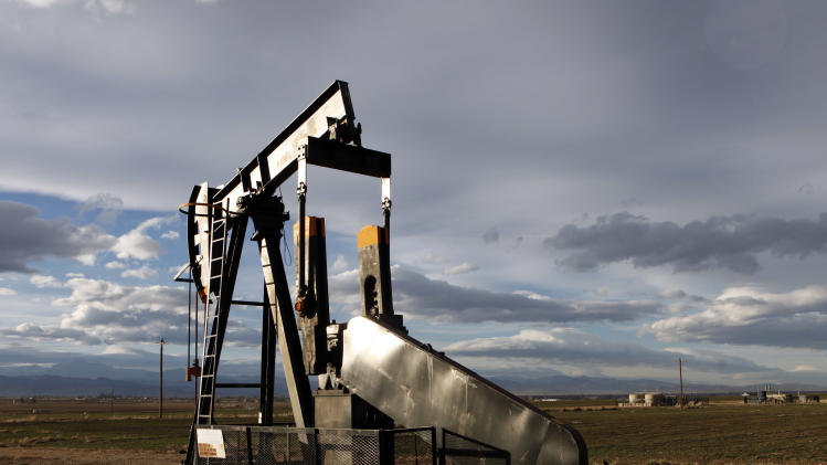 "This Dec. 5, 2012 photo shows an oil pump jack in a field adjacent to a sub-division near Fredrick, Colo. Citizen fears about hydraulic fracturing, a drilling procedure used to pry oil and gas from rock deep underground, have made ""fracking"" the hottest political question in Colorado. In November, citizens in the Denver suburb of Longmont voted overwhelmingly to ban fracking despite heavy opposition from the oil and gas industry and warnings of lawsuits. Now the fracking debate is rocking small local governments _ and leaving the industry wondering how to proceed in a state that has long embraced the oil and gas industry. (AP Photo/Ed Andrieski)"