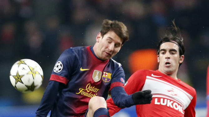 Barcelona's Lionel Messi, left, battles for the ball with Spartak Moscow's Jose Manuel Jurado during their Group G Champions League soccer match at the Luzhniki stadium in Moscow, Russia, Tuesday, Nov. 20, 2012. (AP Photo/Misha Japaridze)