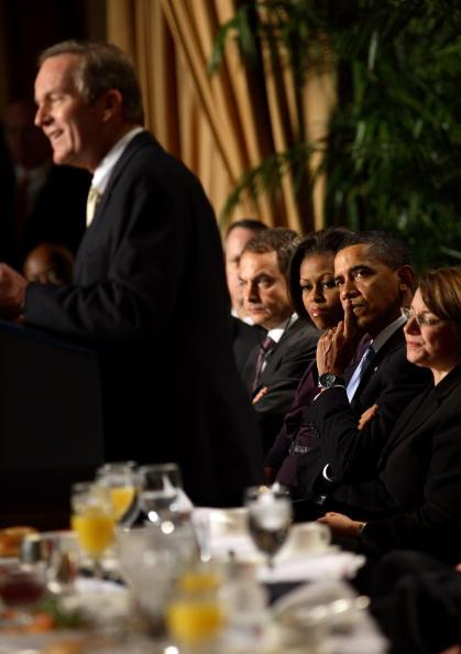 President Barack Obama listens as Rep. W. Todd Akin (R-MO) speaks at the 58th National Prayer Breakfast on February 4, 2010 at the Washington Hilton in Washington, DC. President Obama spoke about bringing back civility and compromise in American politics. The annual gathering was also attended by first lady Michelle Obama, Vice President Joe Biden, Secretary of State Hillary Clinton and the Prime Minister of Spain, José Luis Rodríguez Zapatero. (Photo by Martin H. Simon-Pool/Getty Images)