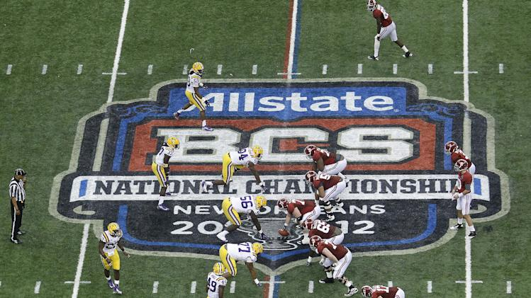 "FILE - In this Jan. 9, 2012, file photo, Alabama, right, prepares to snap the ball against LSU during the first half of the BCS National Championship college football game in New Orleans. College football has taken a big step toward having a final four. BCS Executive Director Bill Hancock said, Thursday, April, 26, 2012, that conference commissioners will present a ""small number"" of options for a four-team playoff to their leagues.  (AP Photo/Bill Haber, File)"