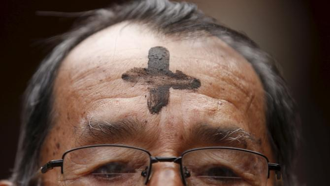 A Catholic faithful participates in the traditional Ash Wednesday service at the 20 de Julio Church in Bogota