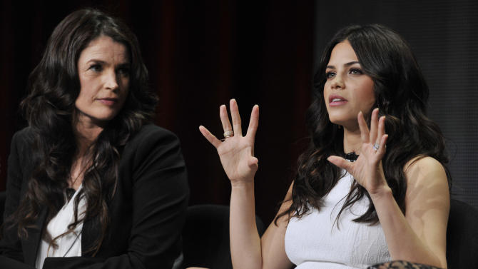 """Jenna Dewan-Tatum, right, a cast member in the Lifetime series """"Witches of East End,"""" answers a question as fellow cast member Julia Ormond looks on during the Lifetime 2013 Summer TCA press tour on Friday, July 26, 2013, in Beverly Hills, Calif. (Photo by Chris Pizzello/Invision/AP)"""