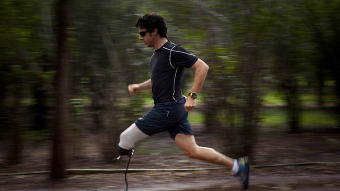 """In this Aug. 28, 2010 photo, Associated Press photographer Emilio Morenatti runs during a photo session in a Mexico City public park, one year after he lost his leg during an attack while on assignment in Afghanistan. For those who lost a limb or more in the Boston Marathon, Monday, April 15, 2013, was the day their world changed forever. Morenatti's world changed also, on Tuesday, Aug. 11, 2009, when during his embed in southern Afghanistan with the U.S. military as a photographer for The Associated Press, which was to have been his last patrol before going home, the eight-wheel armored Stryker vehicle where he was traveling in with U.S soldiers hit a roadside bomb and flipped over, knocking him unconscious. Morenatti, who lost his leg below the knee in the bomb blast, says that if those maimed in Boston were to ask him what was harder, the physical or psychological recovery, he would say the two go hand-in-hand. """"If you don't confront the feelings of loss, the fact that your world has changed, you never fully recover from the amputation,"""" writes Morenatti. (AP Photo/Ramon Espinosa)"""