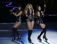 Beyonce performs with Kelly Rowland, left, and Michelle Williams, right, of Destiny&#39;s Child, during the halftime show of the NFL Super Bowl XLVII football game between the San Francisco 49ers and the Baltimore Ravens, Sunday, Feb. 3, 2013, in New Orleans. (AP Photo/Gerald Herbert)
