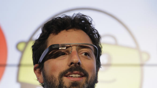Google co-founder Sergey Brin stands on stage during a bill signing by California Gov. Edmund G. Brown Jr., for driverless cars at Google headquarters in Mountain View, Calif., Tuesday, Sept. 25, 2012.  The legislation will open the way for driverless cars in the state. Google, which has been developing autonomous car technology and lobbying for the legislation has a fleet of driverless cars that has logged more than 300,000 miles (482,780 kilometers) of self-driving on California roads. Brin is wearing internet glasses. (AP Photo/Eric Risberg)