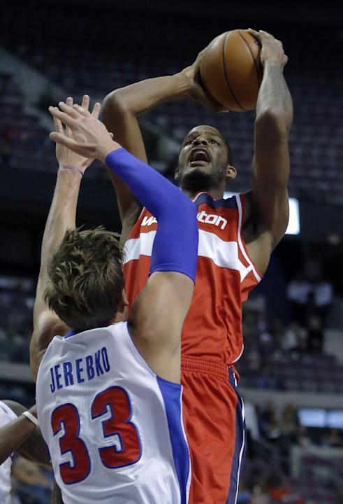 Washington Wizards forward Trevor Ariza takes a shot against Detroit Pistons forward Jonas Jerebko (33) during the first half of a preseason NBA basketball game Tuesday, Oct. 22, 2013, in Auburn Hills
