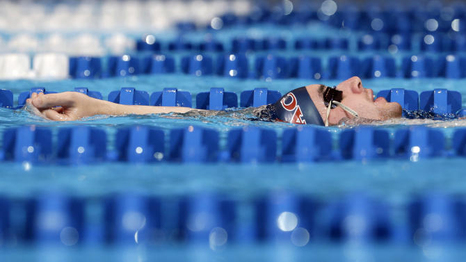 Conor Carlucci, of New York, floats between lanes during practice at the U.S. Olympic swimming trials on Sunday, June 24, 2012, in Omaha, Neb. The trials are to start on Monday. (AP Photo/Mark Humphrey)