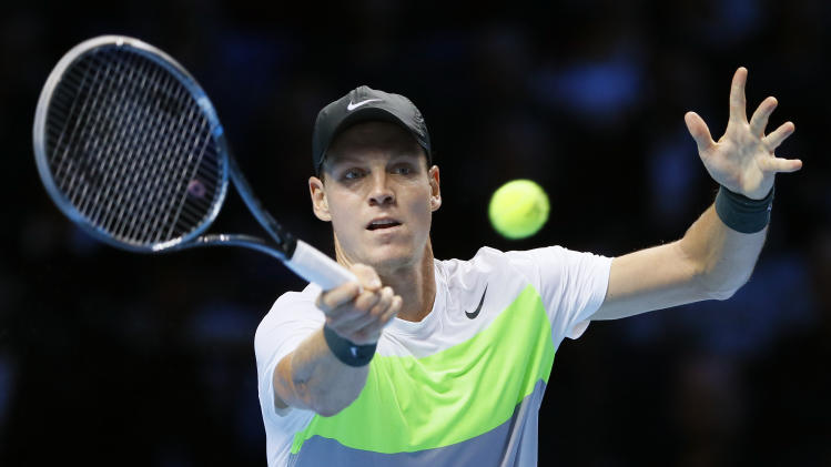 Tomas Berdych of the Czech Republic plays a return to Novak Djokovic of Serbia during their singles tennis match at the ATP World Tour Finals in London Friday, Nov. 9, 2012. (AP Photo/Kirsty Wigglesworth)