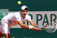 Novak Djokovic hits a return on his way to victory over Tomas Berdych in Monte Carlo on Saturday. Djokovic battled into his second career final in the Monte Carlo Masters, overcoming a stiff challenge from Berdych 4-6, 6-3, 6-2