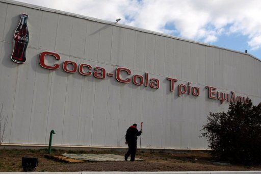 <p>A man walks by a Coca-Cola factory in Thessaloniki, Greece, in February 2012. Coca-Cola's second biggest bottler worldwide said on Thursday it was moving its headquarters from Greece to Switzerland and looking to establish a listing on the London stock exchange.</p>