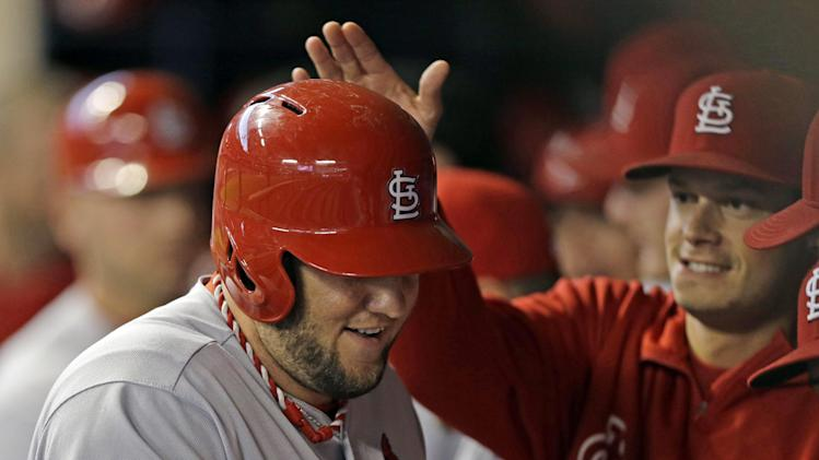 Cardinals clinch playoffs but lose to Brewers 6-4