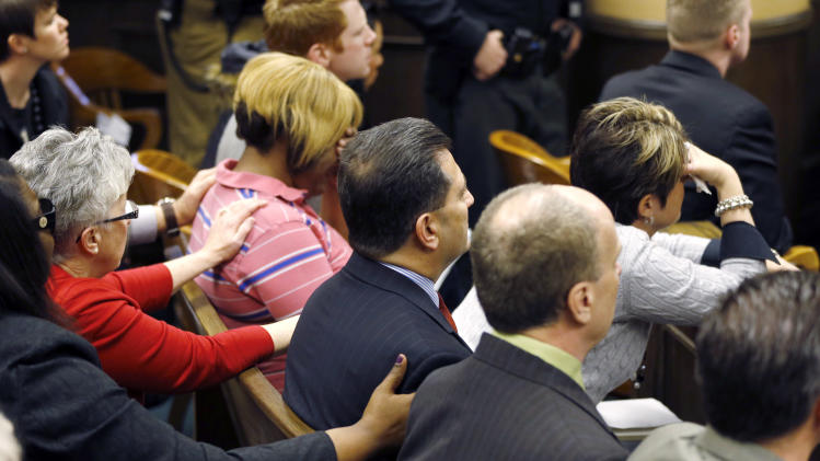 Family and extended family members of 16-year-old Ma'lik Richmond console each other as they hear that he and co-defendant Trent Mays, 17, were found delinquent on rape and other charges after their trial in juvenile court in Steubenville, Ohio, Sunday, March 17, 2013. Mays and Richmond were accused of raping a 16-year-old West Virginia girl in August 2012. (AP Photo/Keith Srakocic, Pool)