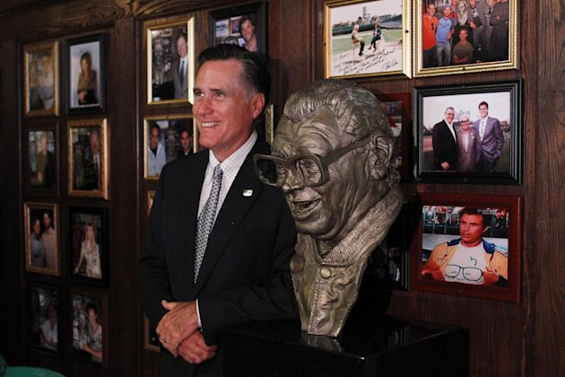 Republican presidential candidate, former Massachusetts Gov. Mitt Romney poses nest to a bust of  famed baseball announcer, Harry Caray after a private fundraising event at Harry Caray's Italian Steak