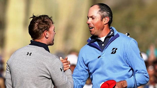 Matt Kuchar shakes hands with fellow American Hunter Mahan of the U.S. after Kucher won the championship match of the WGC-Accenture Match Play Championship in Marana, Arizona (Reuters)