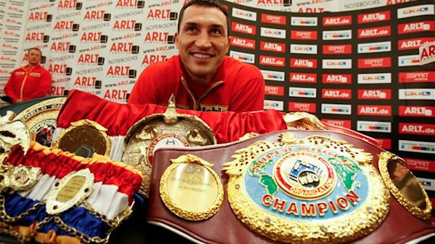 Heavyweight boxing title holder Vladimir Klitschko poses behind his belts during a news conference in Duesseldorf February 27, 2012. Klitschko will fight Jean-Marc Mormeck of France during their IBF/WBO, WBA and IBO world heavyweight championship title fi