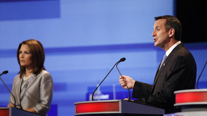 Republican presidential candidate former Minnesota Governor Tim Pawlenty, right, speaks as Rep. Michele Bachmann, R-Minn. listens during the Iowa GOP/Fox News Debate at the CY Stephens Auditorium in Ames, Iowa, Thursday, Aug. 11, 2011. (AP Photo/Charlie Neibergall, Pool)