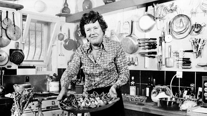 FILE-  In this Aug. 21, 1978 file photo, chef Julia Child displays a salade nicoise she prepared in the kitchen of her vacation home in Grasse, southern France. A foundation set up by Julia Child is in a legal battle in August 2012 with the manufacturer of Thermador ovens, claiming BSH Home Appliances Corp., is using Child's name and image without permission in a marketing campaign of the company's high-end appliances. (AP Photo/File)