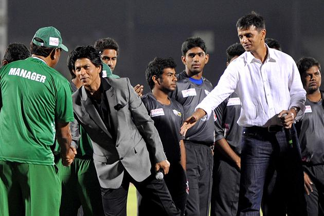 Indian Bollywood actor Shah Rukh Khan (2L) and former Indian cricketer Rahul Dravid (R) meet the teams during the grand opening ceremony of the Toyota University Cricket Championship (TUCC) first matc
