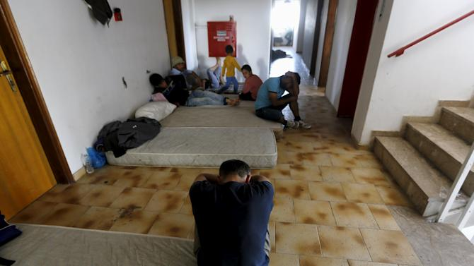 Immigrants from Afghanistan temporarily stay in a deserted hotel on Kos