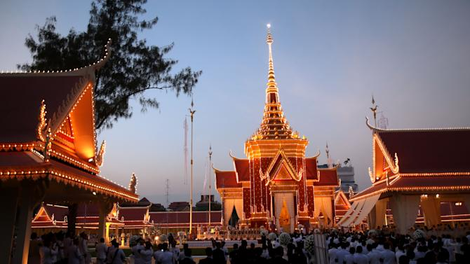 """The crematorium site for Cambodia's former King Norodom Sihanouk is seen at dusk in Phnom Penh Monday, Feb. 4, 2013. Hundreds of thousands of mourners gathered in Cambodia's capital Monday for the cremation of Sihanouk, the revered """"King-Father,"""" who survived wars and the murderous Khmer Rouge regime to hold center stage in the Southeast Asian nation for more than half a century. (AP Photo/Wong Maye-E)"""