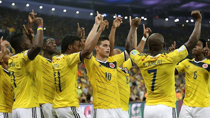 Colombia's James Rodriguez (10) celebrates with his teammates after he scored his side's second goal during the World Cup round of 16 soccer match between Colombia and Uruguay at the Maracana Stadium in Rio de Janeiro, Brazil, Saturday, June 28, 2014