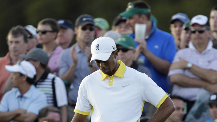 Tiger Woods waits for his group to putt out on the 18th hole during the second round of the Masters golf tournament Friday, April 12, 2013, in Augusta, Ga. (AP Photo/David J. Phillip)