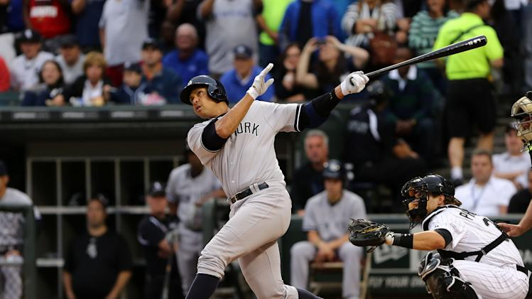 New York Yankees' Ale Rodriguez gets a hit in his first at bat against the Chicago White Sox in the first inning in a baseball game at US Cellular Field in Chicago on Monday, Aug., 5, 2013. (AP Photo/Charles Cherney)