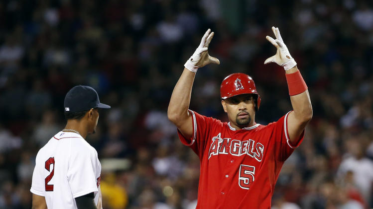 Los Angeles Angels' Albert Pujols (5) signals to his bench while standing on second base as Boston Red Sox shortstop Xander Bogaerts watches after Pujols hit an RBI single and took second on the throw home in the fifth inning of a baseball game at Fenway Park in Boston, Wednesday, Aug. 20, 2014. (AP Photo/Elise Amendola)