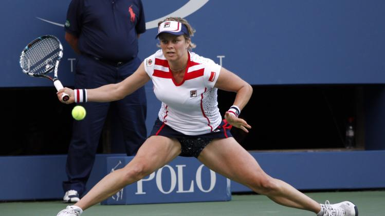Kim Clijsters of Belgium reaches for a shot during her match with Laura Robson of Great Britain in the second round of play at the 2012 US Open tennis tournament,  Wednesday, Aug. 29, 2012, in New York. (AP Photo/Mel C. Evans)