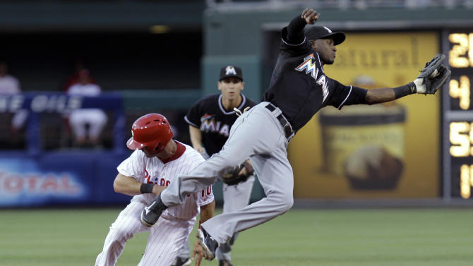 Philadelphia Phillies' Michael Young is safe on a steal at second base as Miami Marlins shortstop Adeiny Hechavarria catches the throw during the fourth inning of a baseball game, Tuesday, June 4, 2013, in Philadelphia. (AP Photo/Laurence Kesterson)