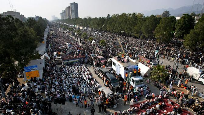 Thousands of a Pakistani Sunni Muslim cleric Tahir-ul-Qadri participate in an anti-government rally in Islamabad, Pakistan, Wednesday, Jan. 16, 2013. Pakistan's leaders received a powerful one-two punch Tuesday as the Supreme Court ordered the arrest of the prime minister in a corruption case and the firebrand cleric led thousands of protesters n another day of anti-government demonstrations in the capital.  (AP Photo/Anjum Naveed)